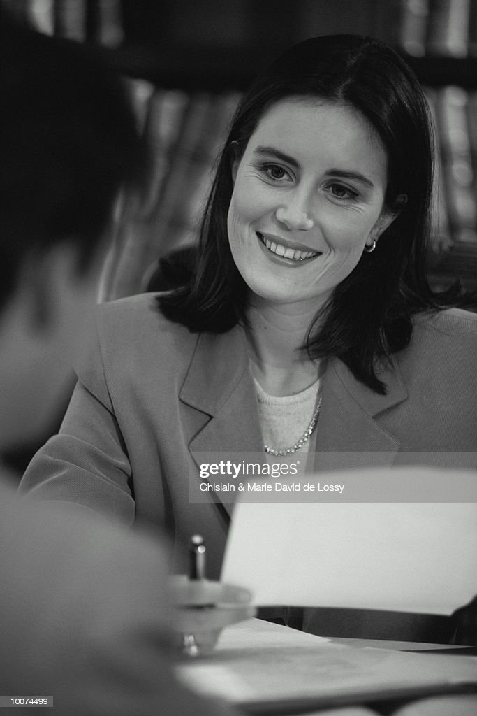 BUSINESS PEOPLE REVIEWING PAPERWORK : Stock Photo