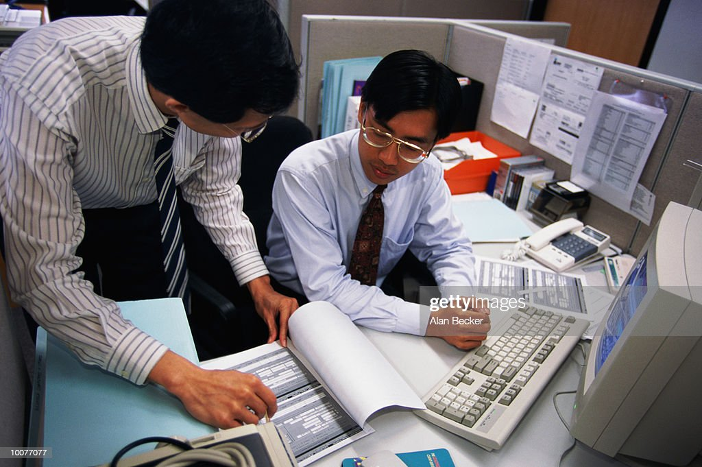 ASIAN MEN AT WORK IN OFFICE IN SINGAPORE : Stock Photo