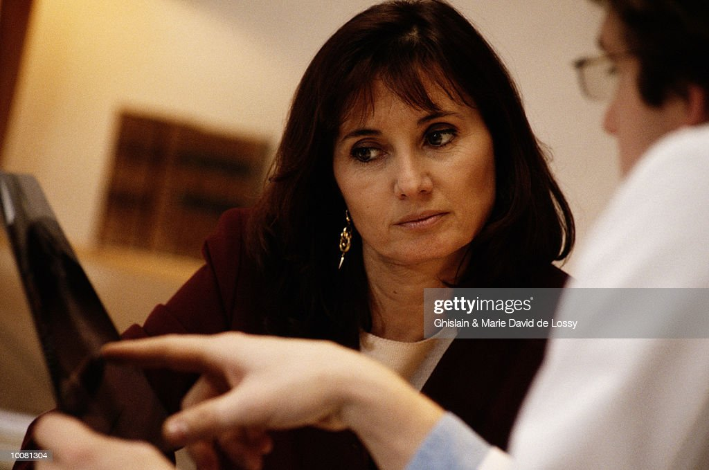 WOMAN IN CONSULTATION WITH FEMALE DOCTOR : Stock Photo