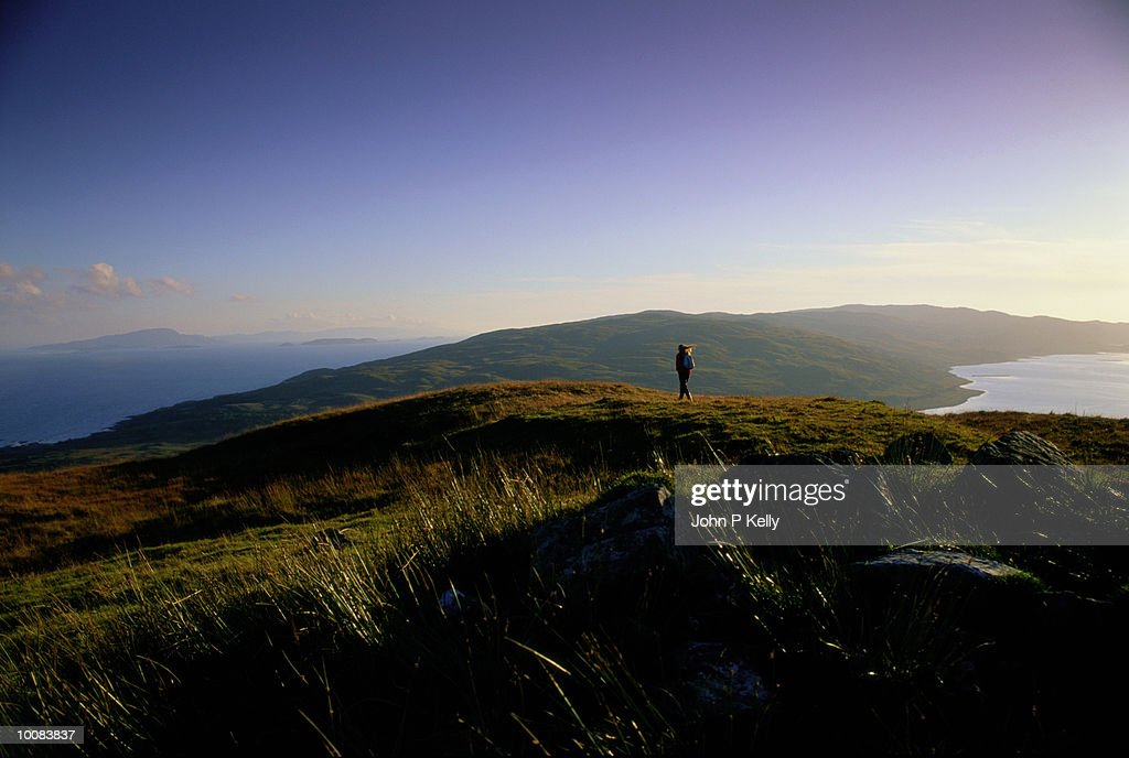 YOUNG WOMAN HIKING IN WEST COAST, SCOTLAND : Stock Photo