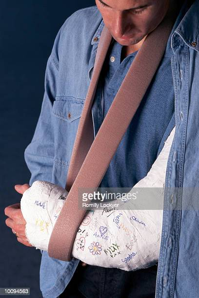 MAN WITH ARM IN PLASTER