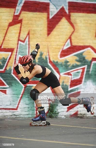 WOMAN INLINE SKATING IN DENVER, COLORADO