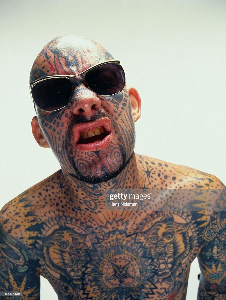 TATTOO MAN WITH SUNGLASSES : Stock Photo