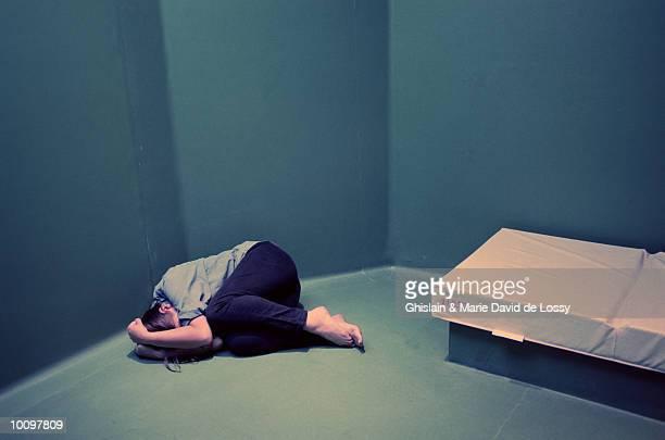DEPRESSED PATIENT CURLED UP IN CORNER