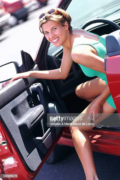 WOMAN GETTING OUT OF CAR