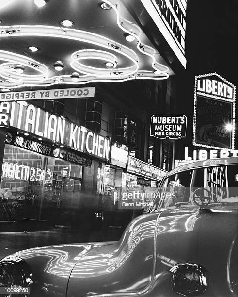 CAR AND NEON LIGHTS IN NEW YORK CITY