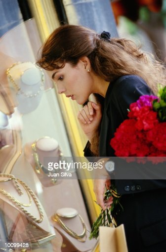 LATIN WOMAN LOOKS AT JEWELRY IN CARACAS, VENEZUELA