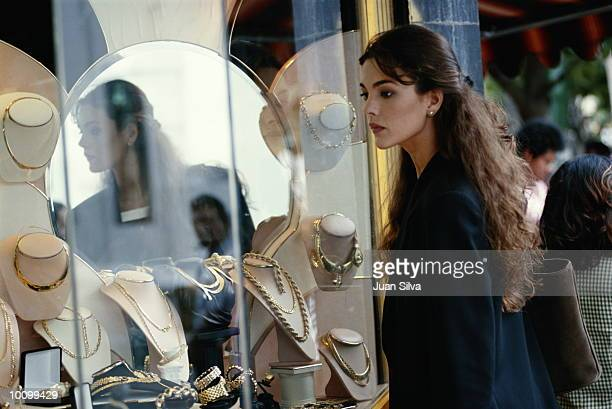 LATIN WOMAN LOOKS AT JEWELRY IN CARACAS, VENEZUELA