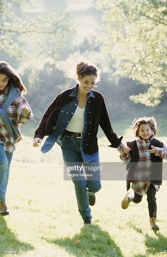 WOMAN AND CHILDREN OUTSIDE : Stock Photo