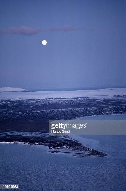 MOON OVER GOLOVIN AND NORTON SOUND IN ALASKA