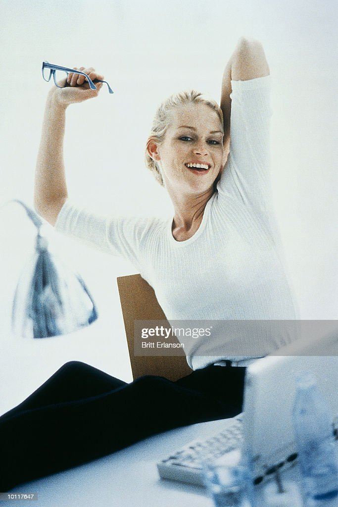 WOMAN WITH COMPUTER, RELAXING POSITION : Stock Photo