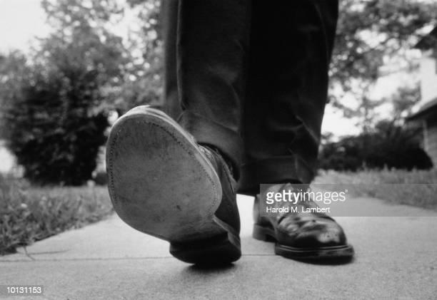 MAN IN WINGTIPS WALKING, 1966