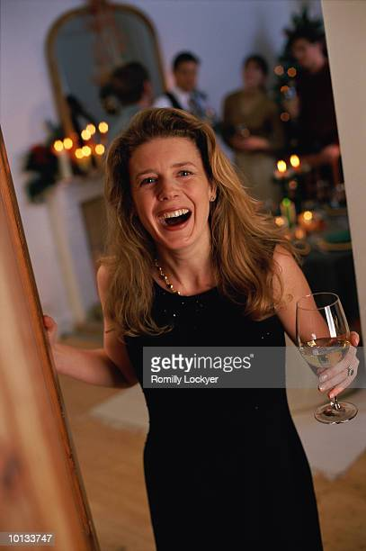 HOSTESS WELCOMING GUESTS TO DINNER, FRIENDS, CELEBRATION