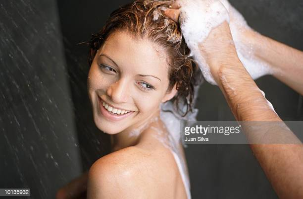 WOMAN GETTING SHAMPOO BY MAN IN SHOWER