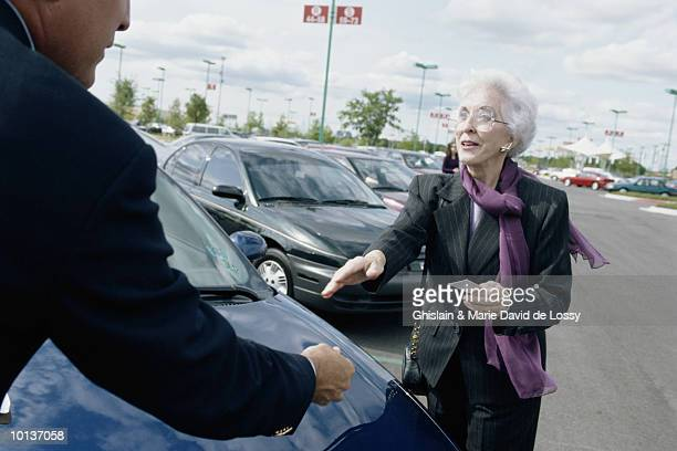 OLDER WOMAN WITH CAR SALESMAN