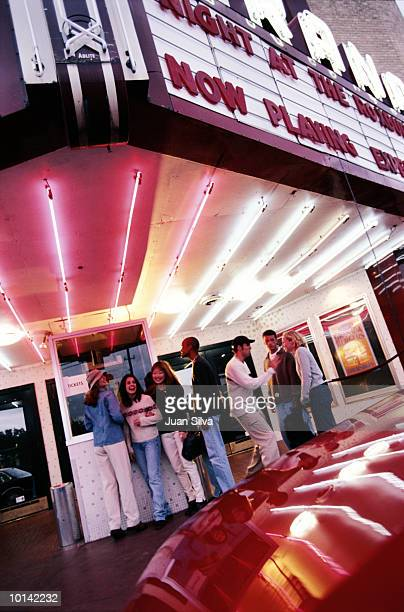 YOUNG GROUP WAITING IN LINE TO MOVIE THEATER