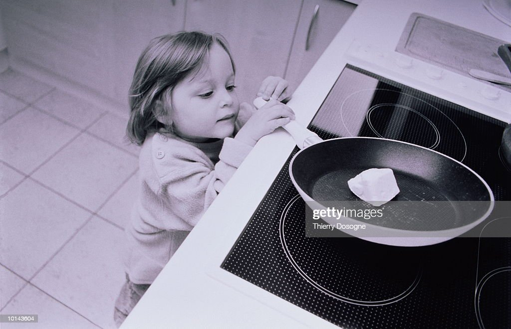 YOUNG GIRL WITH SKILLET, DANGER : Stock Photo