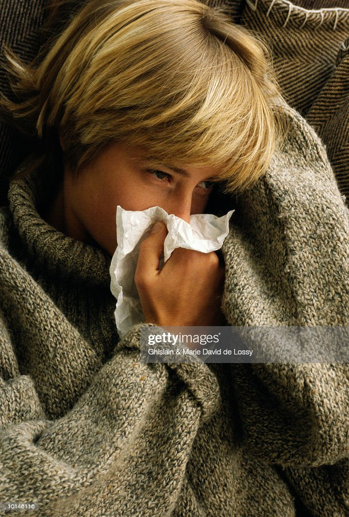 TEEN GIRL WITH TISSUE : Stock Photo