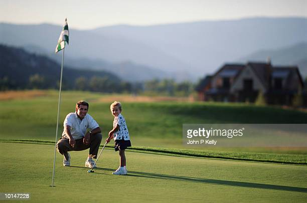 FATHER WITH YOUNG SON, GOLF LESSON, WESTERN COLORADO