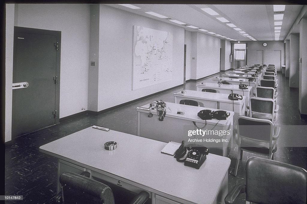 EMPTY ROW OF DESKS IN OFFICE, CIRCA 1955 : Stock Photo
