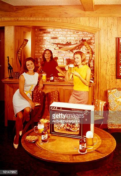 WOMEN DRINKING BEER AND WATCHING FOOTBALL