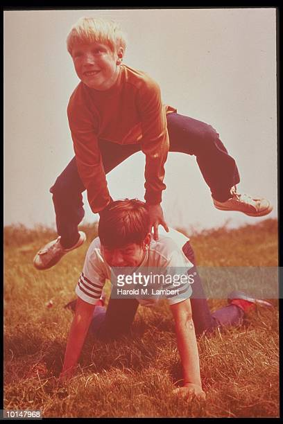 2 BOYS PLAYING LEAPFROG, 1972