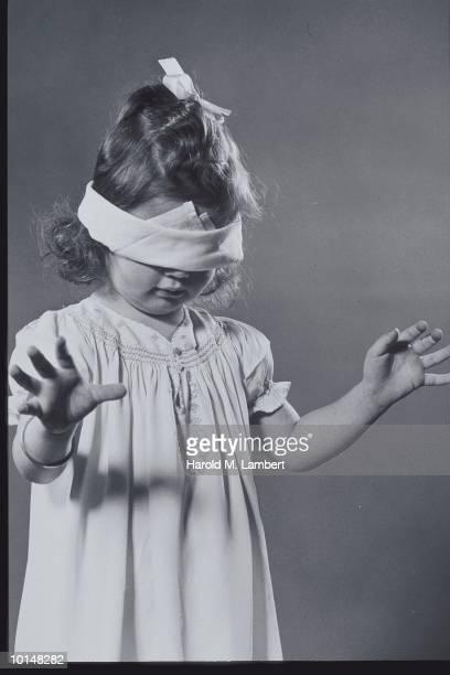 GIRL WEARING BLINDFOLD , 1940S