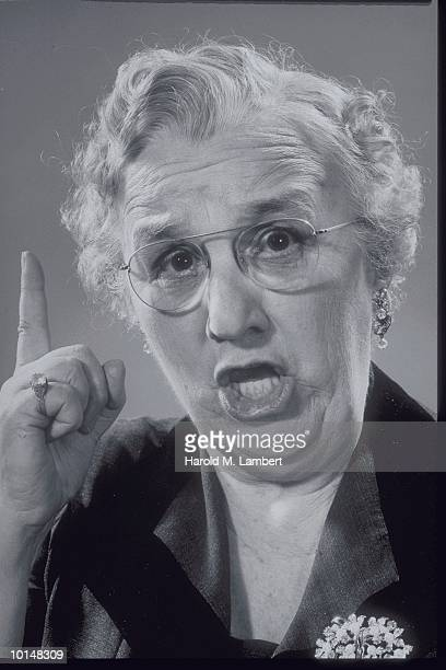 OLDER WOMAN SPEAKING, POINTING