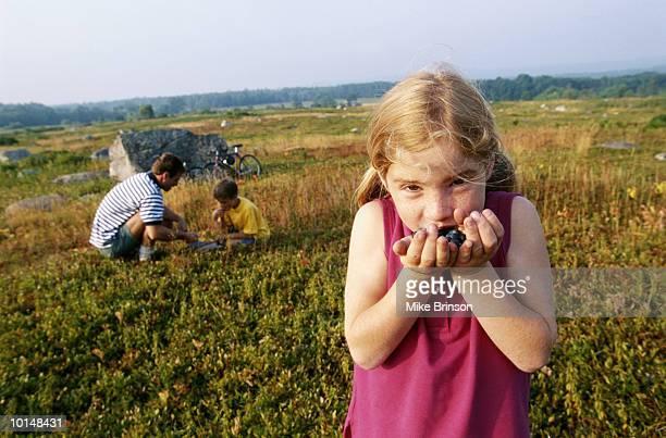 MAINE, GIRL ENJOYING BLUEBERRY HARVEST