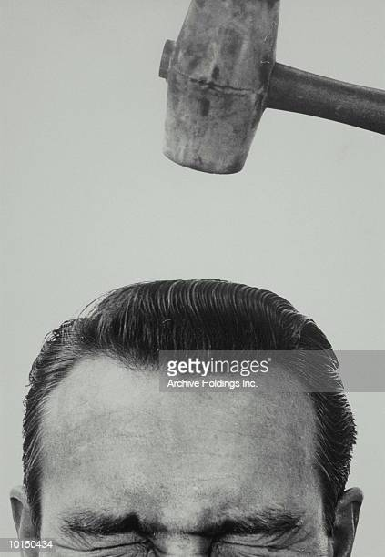 MALLET COMES DOWN TO HIT MANS HEAD, 1950S