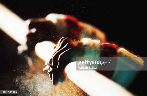 GYMNASTICS, HANDS ON BARS, YOUNG WOMAN