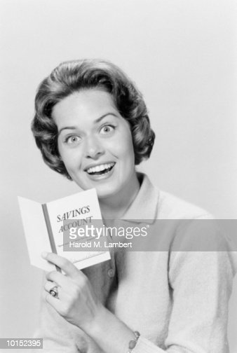 HAPPY WOMAN LOOKING AT HER BANK BOOK : Stock Photo