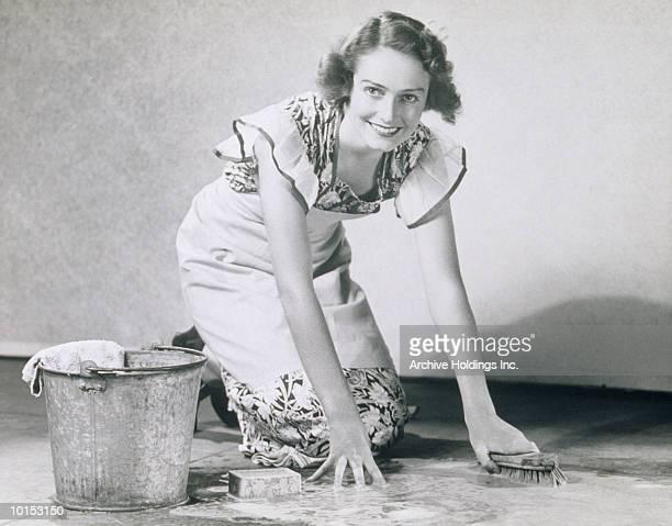 WOMAN SCRUBBING FLOOR, 1930S