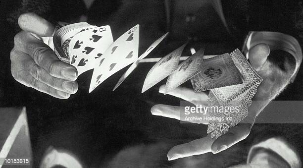 MANS HANDS SHUFFLE A DECK OF CARDS, 1950S