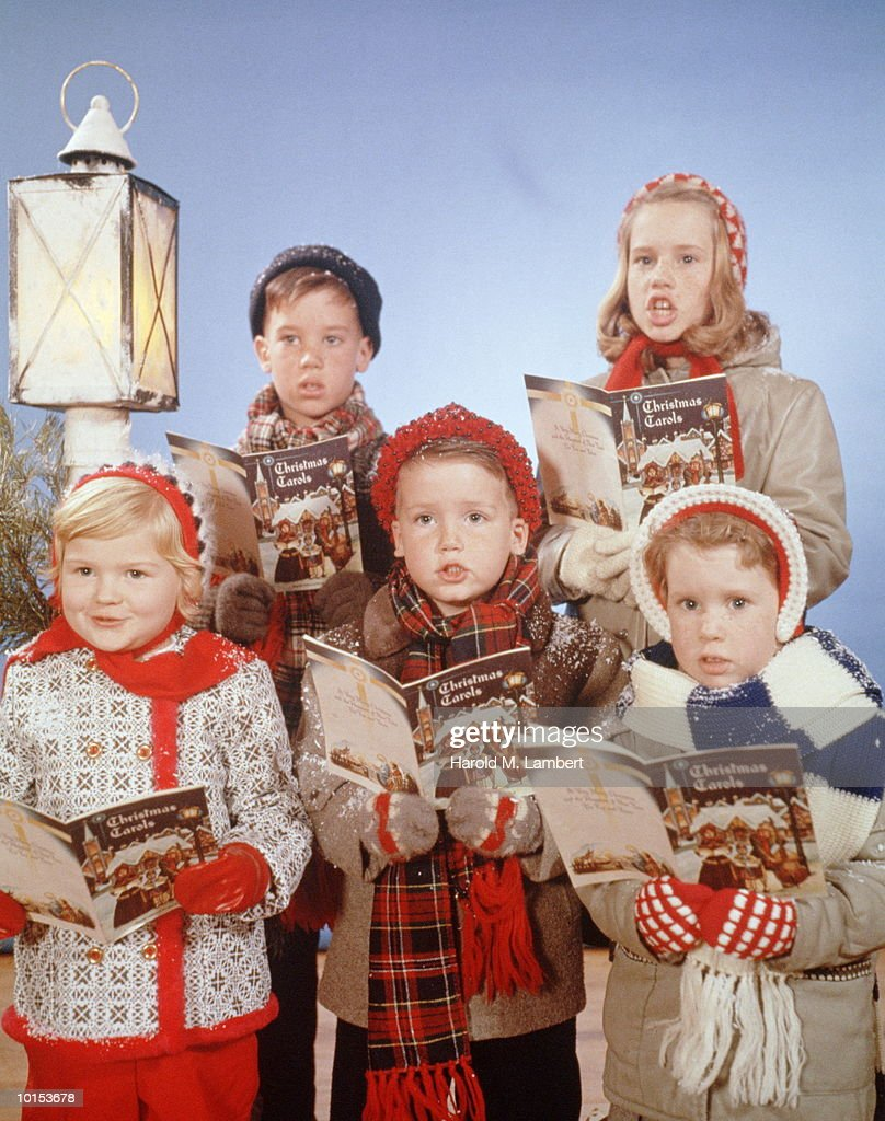 KIDS SING FROM BOOKS OF CHRISTMAS CAROLS