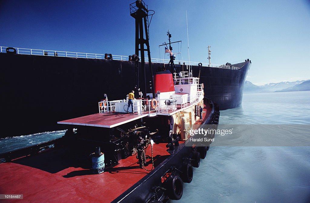 TUGBOAT WITH SUPER TANKER OIL TERMINAL, VALDEZ, ALASKA