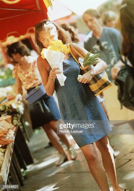 WOMAN WITH FLOWERS AND SHOPPING BAG