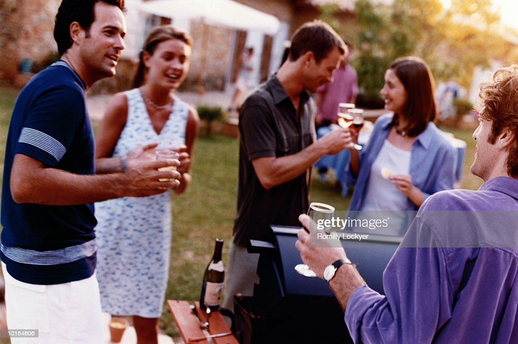 BBQ PARTY AT NIGHT : Stock Photo
