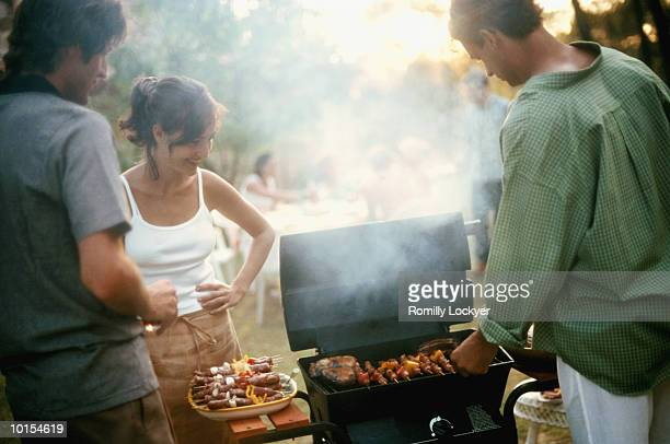 GROUP OF FRIENDS, EVENING BBQ, COOKING
