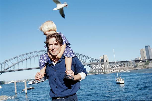 MAN WITH CHILD ON SHOULDERS, SYDNEY