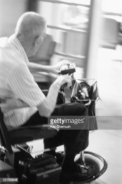 ELDERLY MAN ON WALKER IN DINING ROOM, VIRGINIA