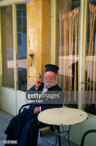 GREEK ORTHODOX PRIEST ON CELL PHONE