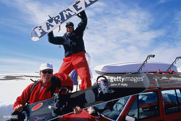 SNOWBOARDERS ON TOP OF CAR, COLORADO
