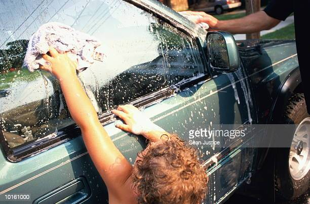 DAD AND SON WASHING THE CAR