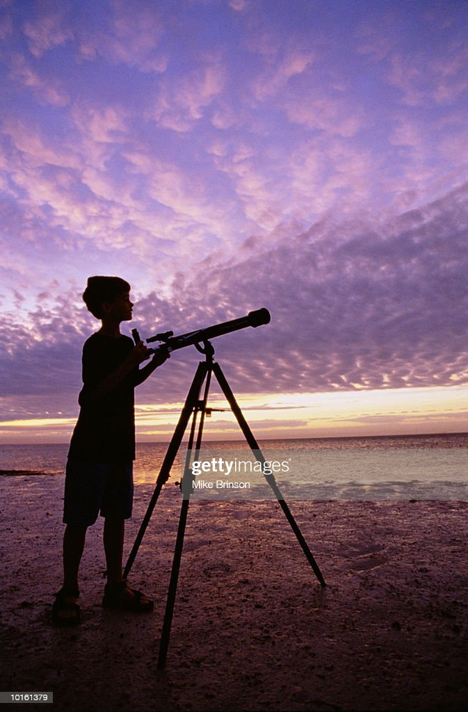 Boy Looking Through Telescope Stock Photo | Getty Images