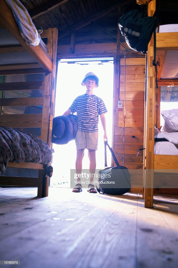 BOY ARRIVING AT SUMMER CAMP : Stock Photo