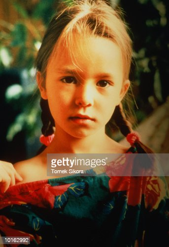 YOUNG GIRL STARING : Stock Photo