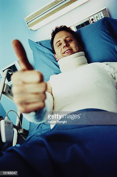MAN IN BODY CAST GIVING THUMBS UP