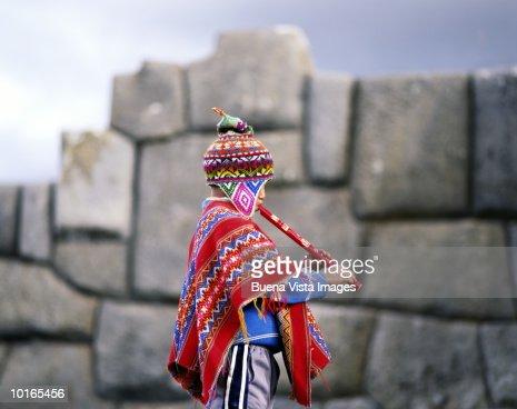 QUECHUA INDIAN BOY PLAYING FLUTE, PERU : Stock Photo
