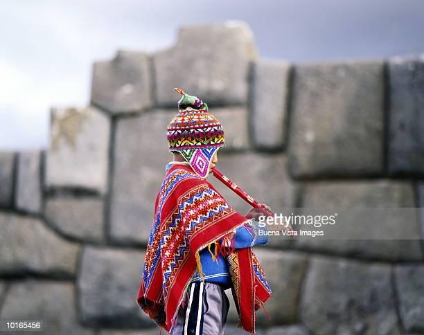 QUECHUA INDIAN BOY PLAYING FLUTE, PERU